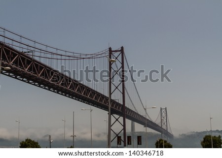 Huge road and rail bridge in Lisbon, Portugal - stock photo