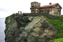 Huge rocks on the ocean, sea summer landscape, old stone building on a high cliff, Gamova lighthouse, Russia, Russia, Primorsky Krai, Peter the great Bay, Babkin Cape.