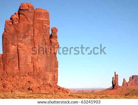 Huge sandstone rock formations tower above floor of Monument Valley on Navajo Indian reservation