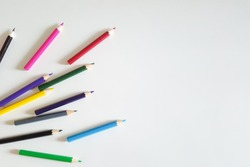Huge set of colorful pencils on white table background. Top view.