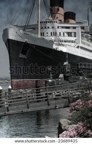 "Huge ship at dock with smoke coming out of top.  This photo has a ""vintage"" look with a slight texture (grain) effect."
