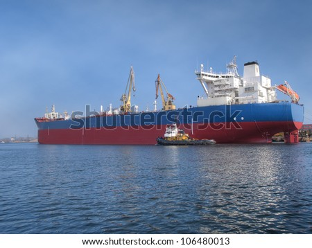 Huge ship moored to a wharf - stock photo