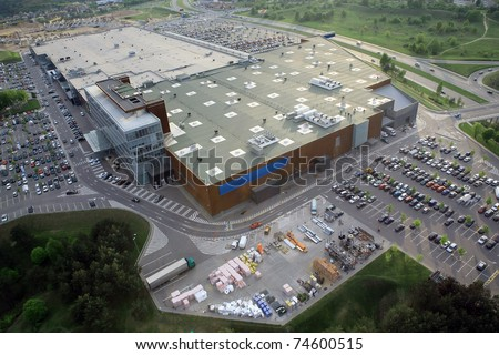 Huge shopping mall of household goods with a lot of parking space, aerial view