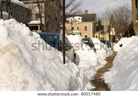 Huge snow piles on city street