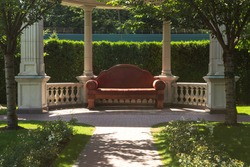 Huge sofa in a rotunda in the garden and footpath. Mezhyhirya is the main landmark of Ukrainian corruption.  Beautiful place with large gardens and wonderful arbors and footpaths