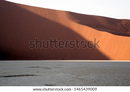Huge solitude  crossing of the  vastness desert in the colorful and illuminated desert in Namibia #1465439009