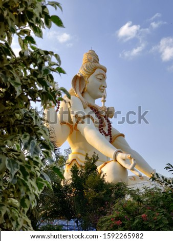 Huge statue of lord shiva hindu god with snake in the neck and trishool in his hand  Stock photo ©
