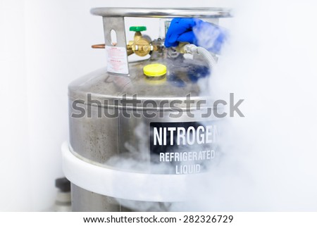 Huge tank of nitrogen half covered by fume caused by evaporation