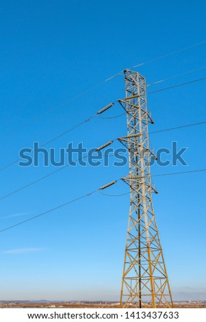 Huge Transmission tower in a beautiful blue sky day #1413437633