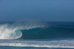 huge tsunami wave breaking on the beach