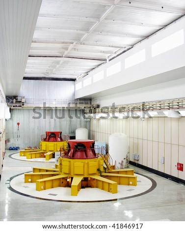 Huge water turbine generators. Hydroelectric powerplant. Interior