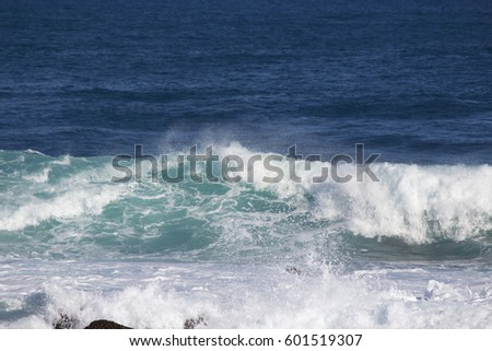 Huge  waves of the Indian Ocean  rolling in at famous Yallingup Beach,South Western Australia a world famous surfing mecca, on a cold yet sunny winter morning. #601519307