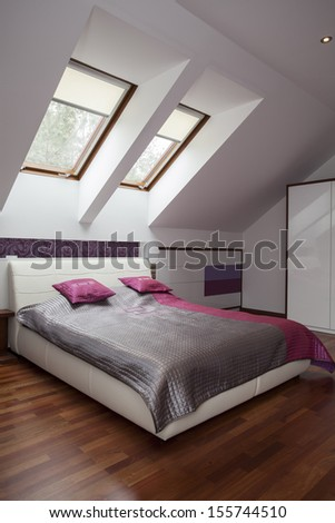 Huge White Bed With Silver And Pink Blanket
