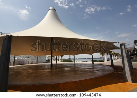 huge white tent as an umbrella
