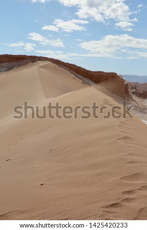 Huge wind-swept sand dune in Chile's Atacama Desert, vertical view. #1425420233