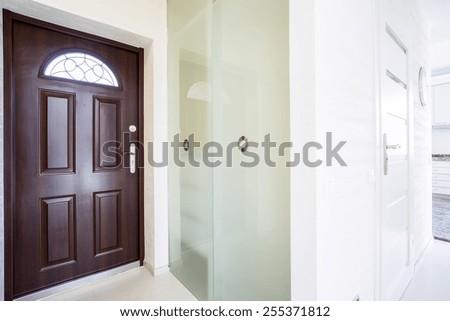 huge wooden entrance door inside modern apartment