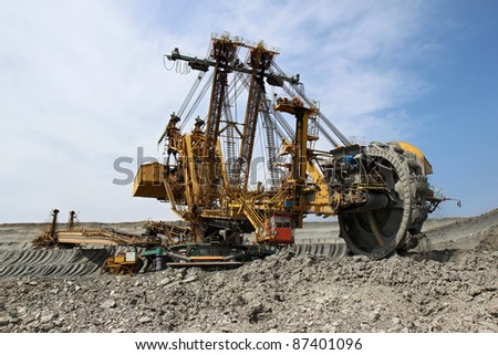 huge yellow overburden excavator in brown coal mine