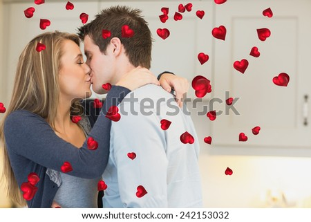Hugging and kissing couple against valentines heart design #242153032