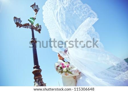 hugging bridal couple