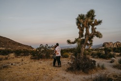 Hugging couple in Joshua Tree National Park