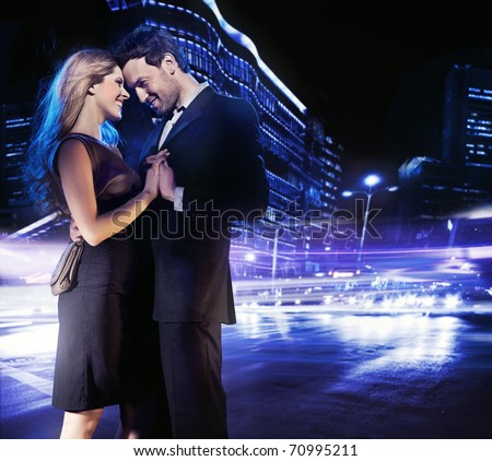 Hugging couple over city background