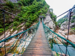 Huihang Ancient Trail Hiking Tour,  bridge over big rocks in mountains between Anhui and Zhejiang, China
