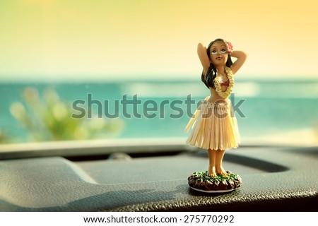 hula dancer doll on hawaii car...