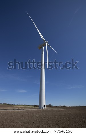 Human at the base of two megawatt (MW) wind turbine (80 meter rotor span, nacelle height 59.9 meters, max height 99.9 meters), Denmark