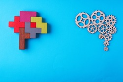 Human brain is made gear mechanism and colourful shapes on blue background. Two different thought processes. The concept of rational and irrational thinking.