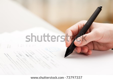 Human business men hand pen writing paper document