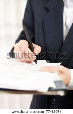 Human business men hand pen writing paper document - stock photo