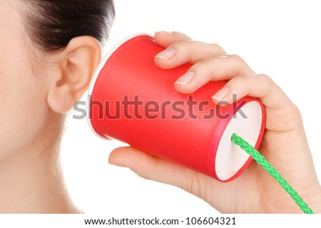 Human ear and paper cup near it close-up isolated on white