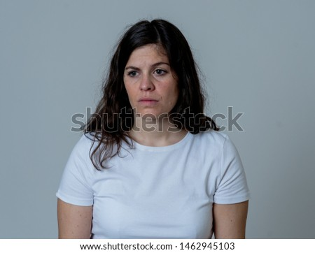 Human emotions and expressions and mental health concept. Young sad woman suffering from depression looking worried and thoughtful. Feeling sorrow and emotional pain. Studio shot With copy space. #1462945103