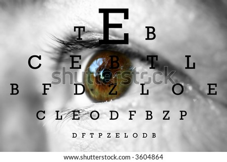 human eye with test vision chart - stock photo