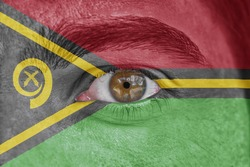 Human face and eye painted with flag of Vanuatu
