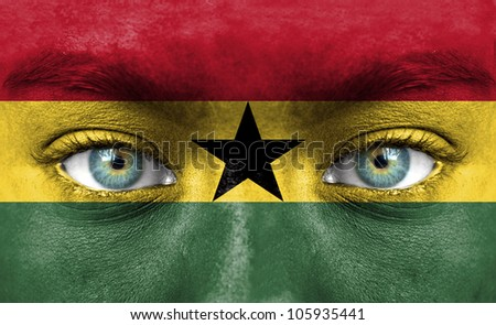 Human face painted with flag of