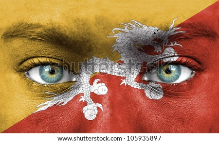 Human face painted with flag of Bhutan