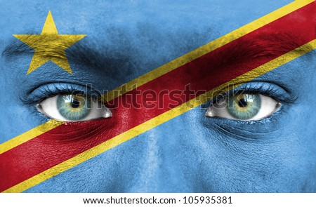 Human face painted with flag of Democratic Republic of Congo