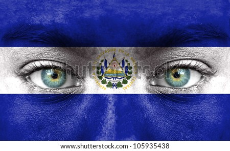 Human face painted with flag of El Salvador