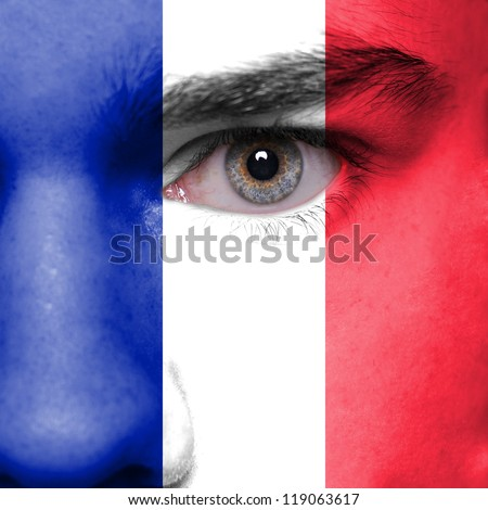 Human face painted with flag of France