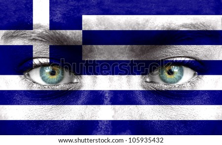 Human face painted with flag of Greece