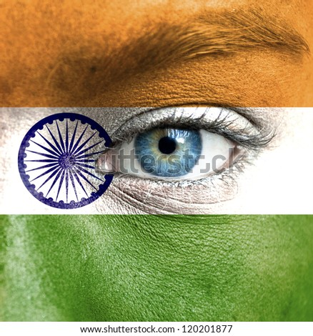 Human face painted with flag of India