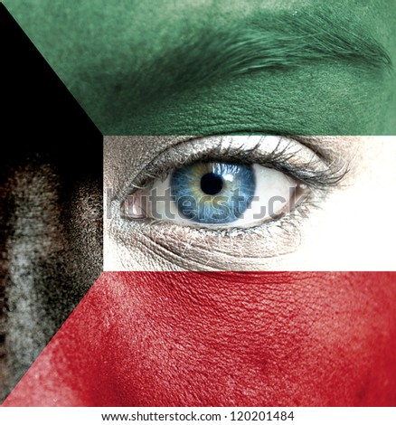 Human face painted with flag of Kuwait