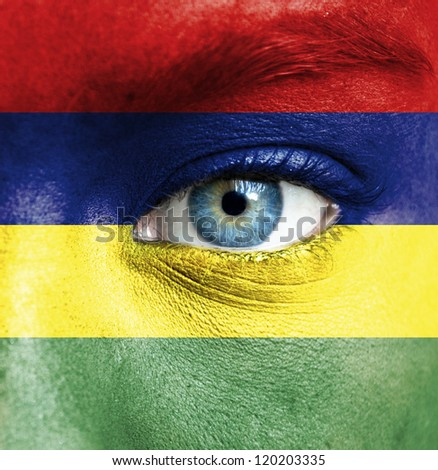 Human face painted with flag of Mauritius