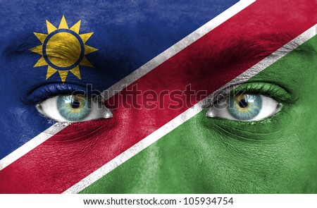 Human face painted with flag of Namibia