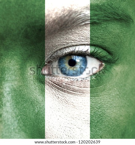 Human face painted with flag of Nigeria