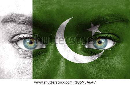 Human face painted with flag of Pakistan