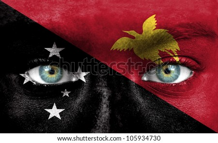 Human face painted with flag of Papua New Guinea