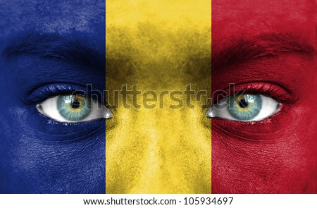Human face painted with flag of Romania