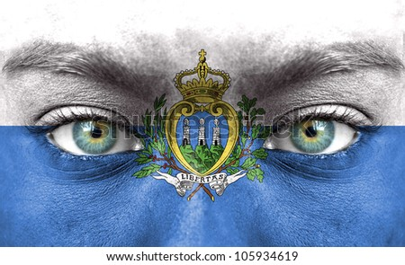 Human face painted with flag of San Marino